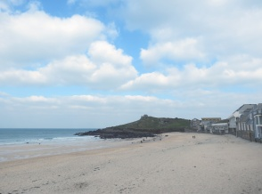 The building stands proudly above Porthmeor Beach