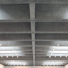 The concrete beams and roof lights in the new gallery space